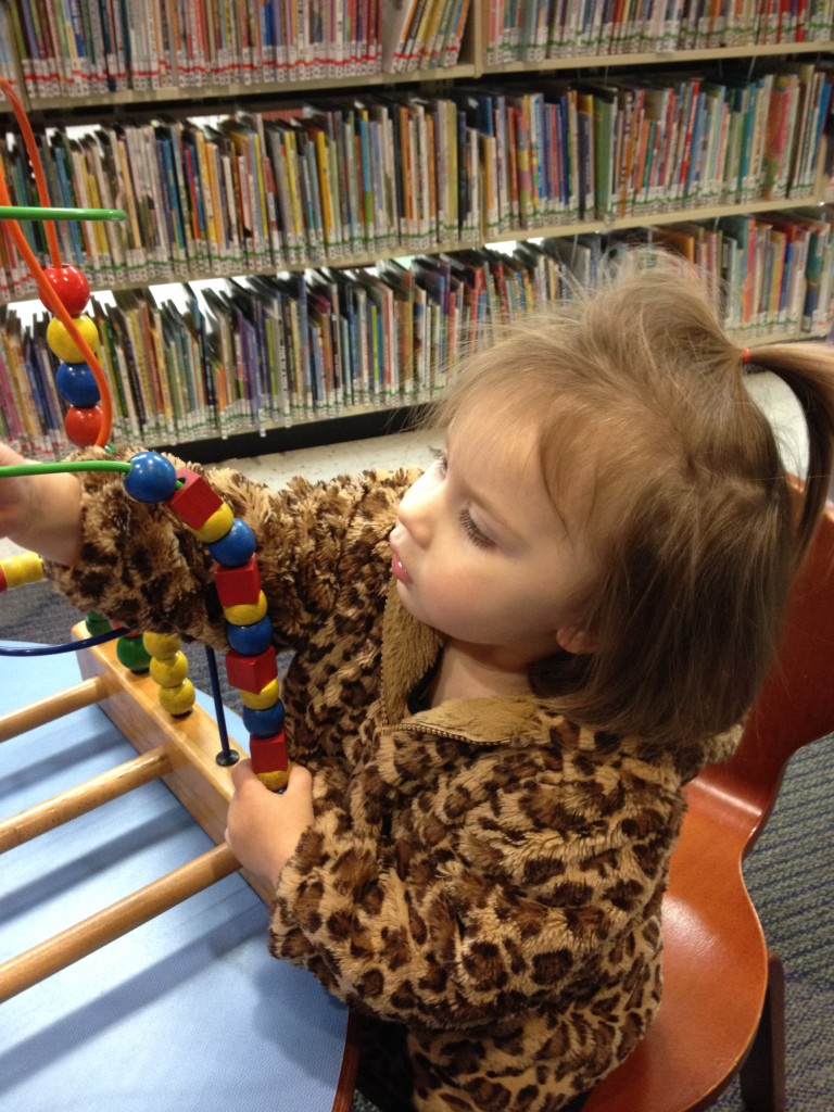 Playing with beads at the library